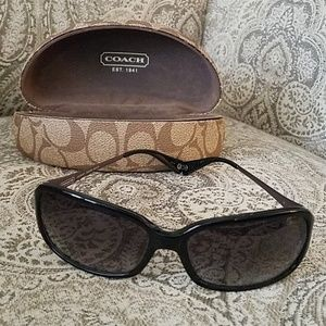 Coach sunglasses. Black with silver accents.